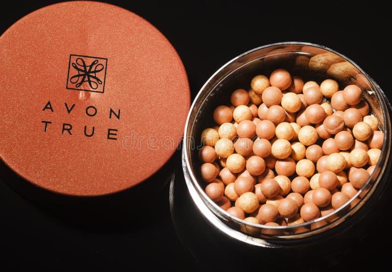 Avon-Glühen, welches die Perlen lokalisiert auf dunklem Hintergrund bronziert stockbilder