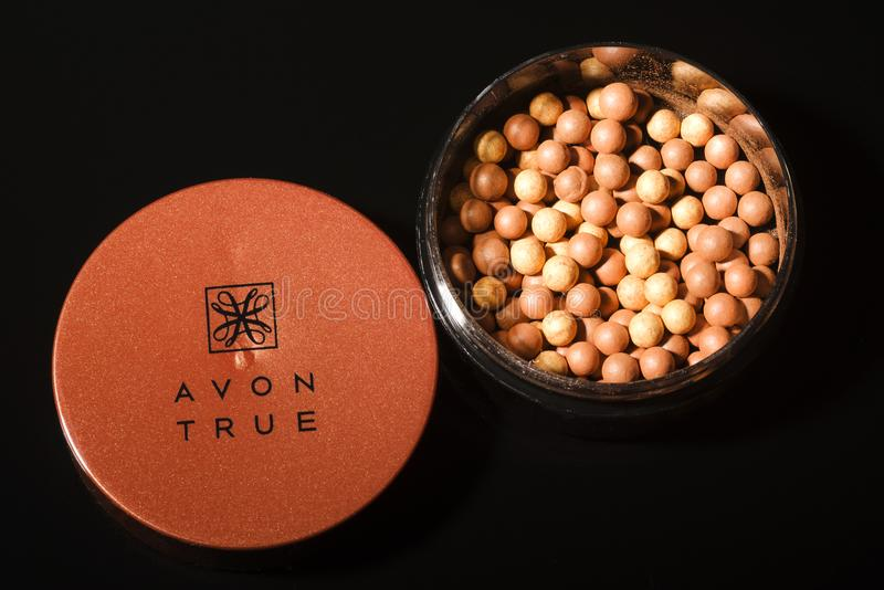 Avon glow bronzing pearls isolated on dark background. stock photo