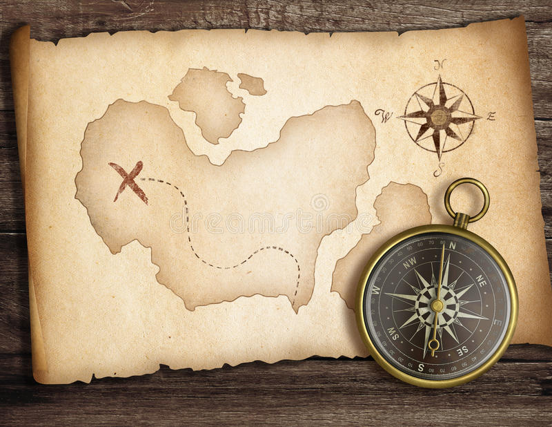 Avonturenconcept. Oud kompas op lijst met schatkaart royalty-vrije illustratie