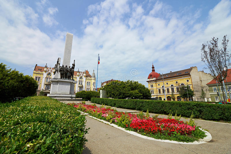 Avram Iancu square in Cluj, Romania. Avram Iancu square shot in Cluj, Romania with the Romanian Soldier Monument, the prefecture and the Protestant Theological royalty free stock images