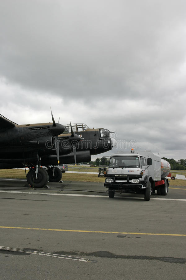 Avro Lancaster with refuelling truck at Farnborough. The Lancaster bomber - PA474, acquired by the BBMF in 1973, is one of only two surviving airworthy royalty free stock images