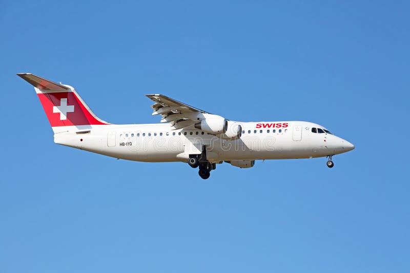 AVRO RJ100 Swiss Air. ZURICH - JULY 18: AVRO RJ100 landing in Zurich airport after short haul flight on July 18, 2015 in Zurich, Switzerland. Zurich airport is stock images