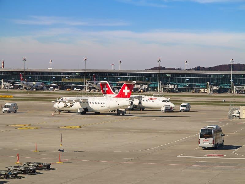 AVRO RJ100 Swiss Air. ZURICH - JULY 18: AVRO RJ100 in Zurich airport after short haul flight on July 18, 2015 in Zurich, Switzerland. Zurich airport is home for stock photo