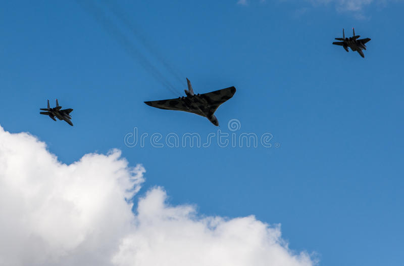 Avro Vulcan XH558. With F-15E's of the 48 FW flying over RAF Lakenheath, Suffolk, UK.nThe Spirit Of Great Britain is the only airworthy example of the 134 Avro stock photos