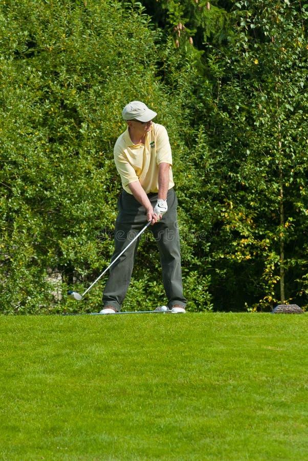 avslutar golfare hans jupan swing royaltyfria foton
