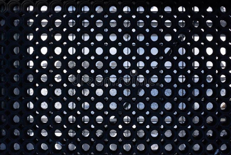 Avsnitt av ett svart extremt robust cirkelgummi som är mattt för bransch och seminarium fotografering för bildbyråer