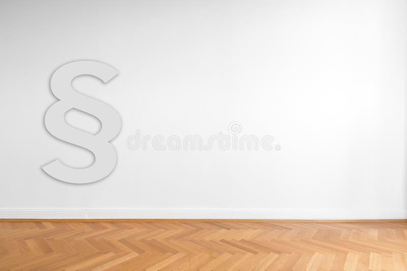 Avsnittsymbol som är främst av ehiteväggbakgrund - lagbegrepp arkivfoton