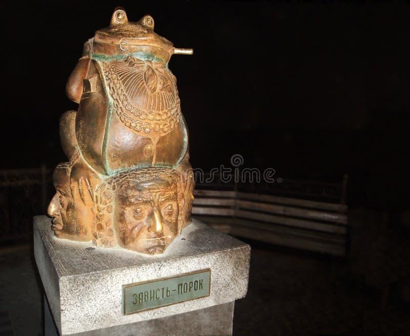 Avund - last Monumentgirighet royaltyfria bilder