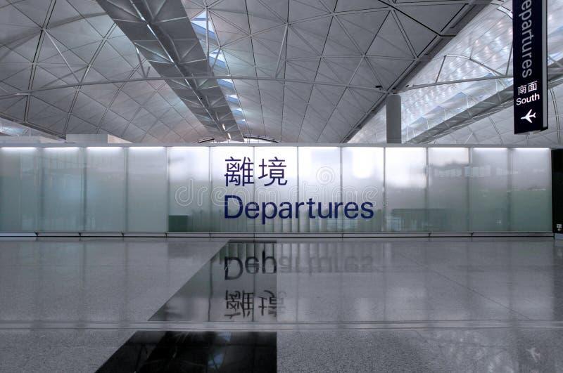 Avvikelsetecken på en flygplats, skott i asia, Hong Kong arkivbilder