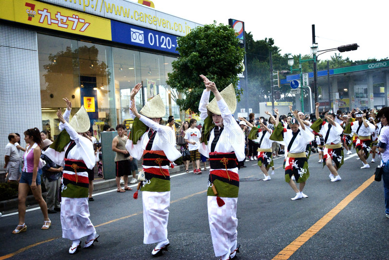Awa Dance /Awa Odori. Awa odori is part of the Bon festivities, which are held to welcome one's ancestors back to this world for a few days. They march through royalty free stock photo