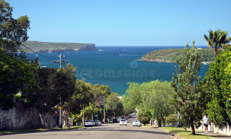 Awaba Street directing to Balmoral beach. Entrance of Sydney Harbour with North Head and South royalty free stock image