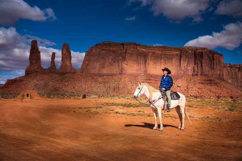 Awaiting the challenge. This is a photograph of a cowboy on horseback at Monument Valley stock photos