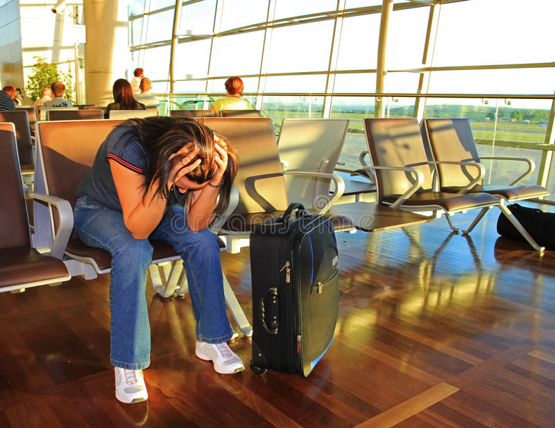 Awaiting for a late plane. Depressed woman awaiting for a late plane royalty free stock photography