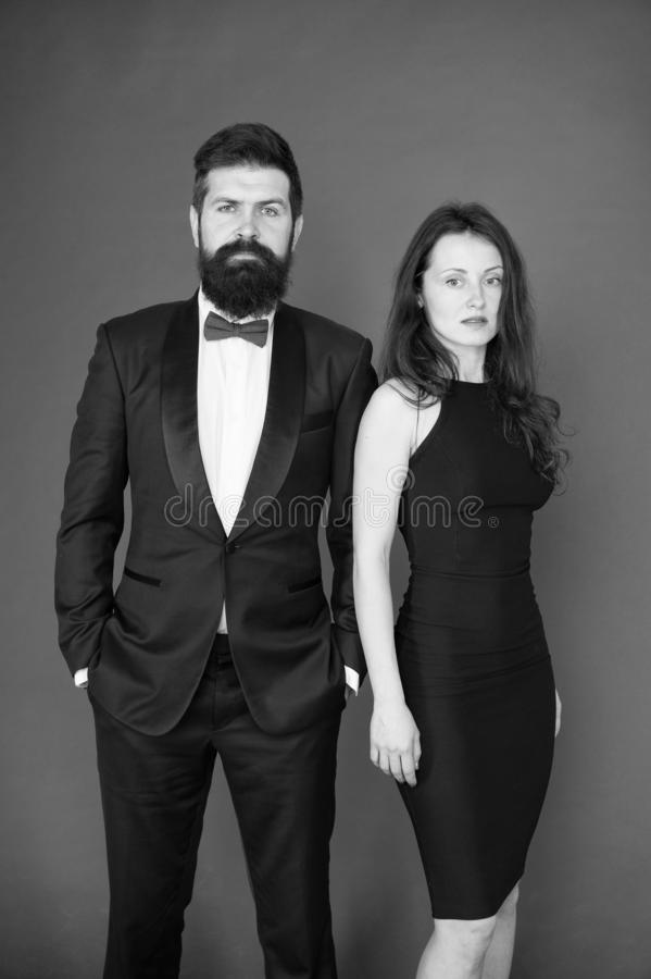 Award ceremony concept. Bearded gentleman wear tuxedo girl elegant dress. Formal dress code. Visiting event or ceremony. Couple ready for award ceremony. Main royalty free stock photo