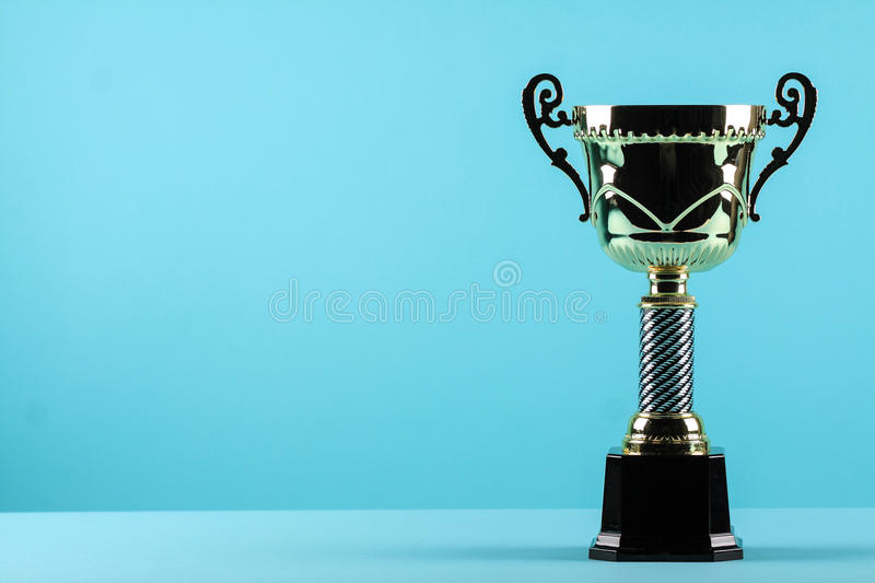 Download Award Winning Trophy In Blue Background Stock Photo
