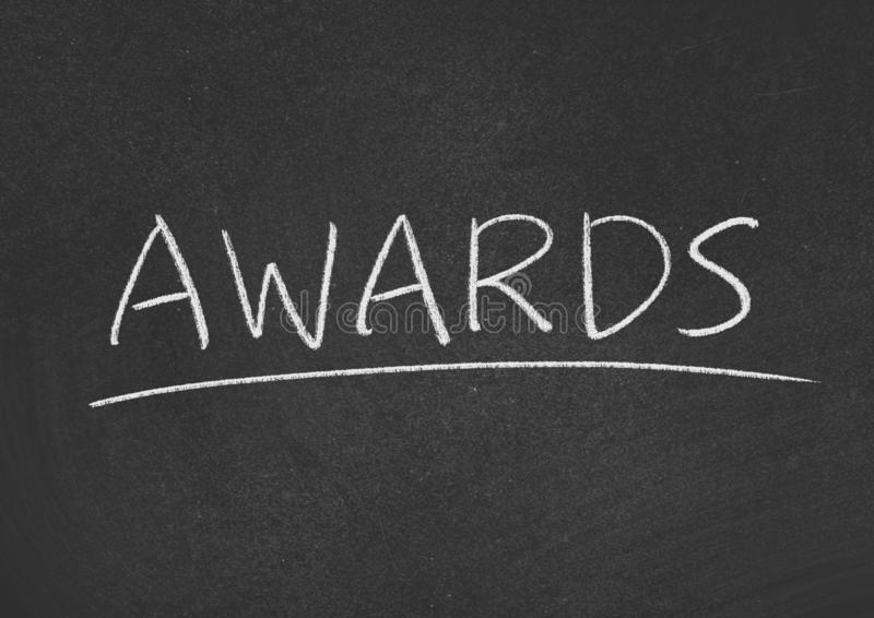 Awards. Concept word on a blackboard background stock image
