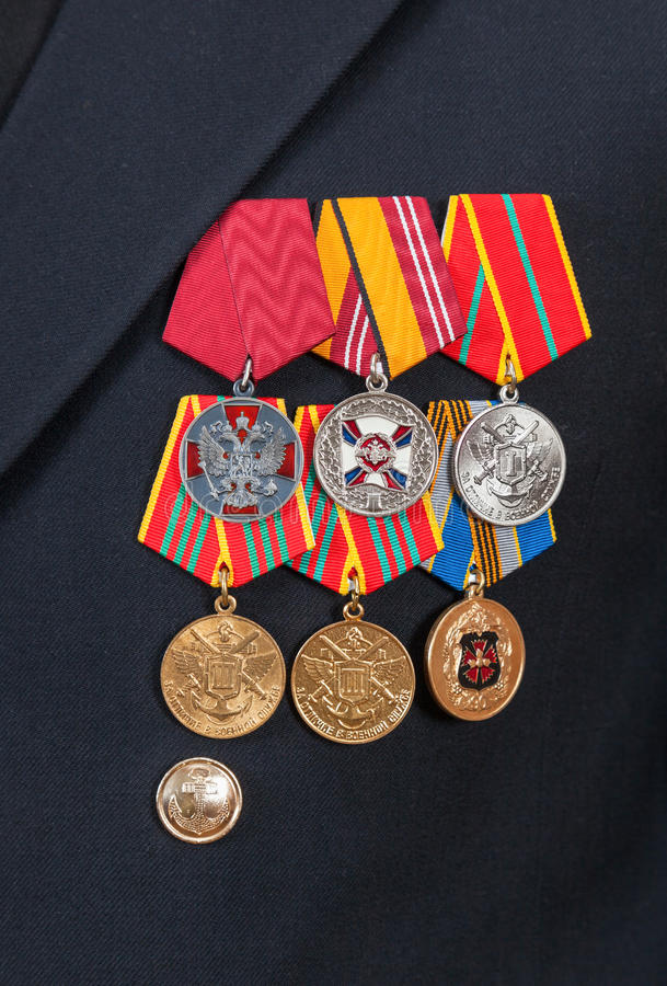 Awards and medals on the russian navy uniform. Different awards and medals on the russian navy uniform royalty free stock images