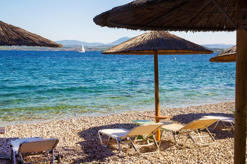 Awe  beach on greek island  and  white sail at  distance. Awe  beach on greek island  and  white sail at . distance. Majestic sunny morning royalty free stock images