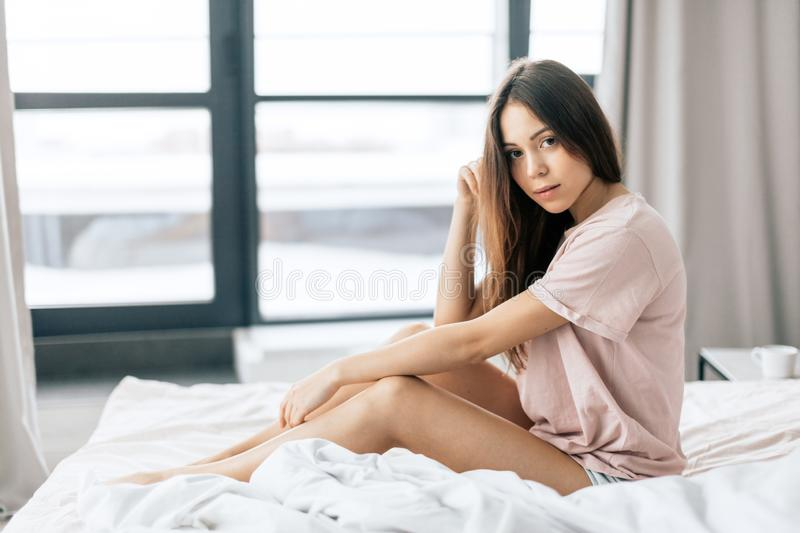 Awesoem girl with long brown hair is looking at the camera stock photo