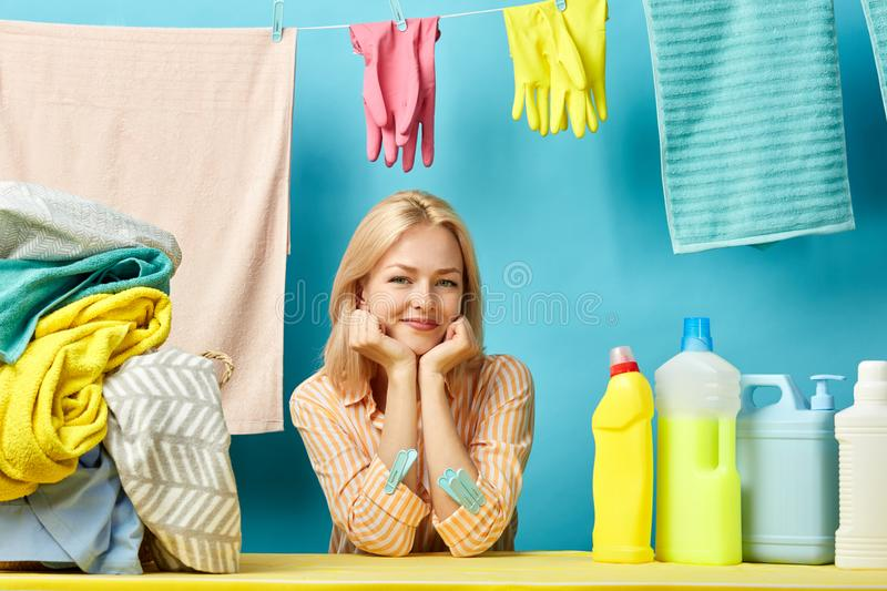 Awesome beautiful blonde woman advertising washing liquid, detergent royalty free stock images