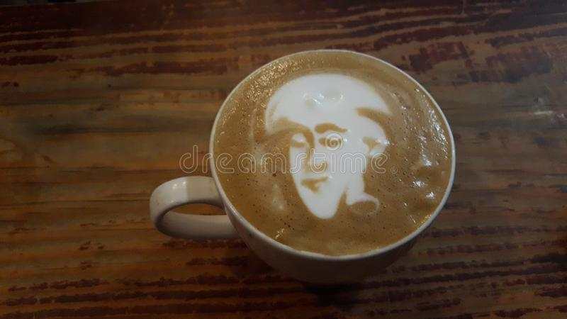 Awesome coffee having human face stock photos