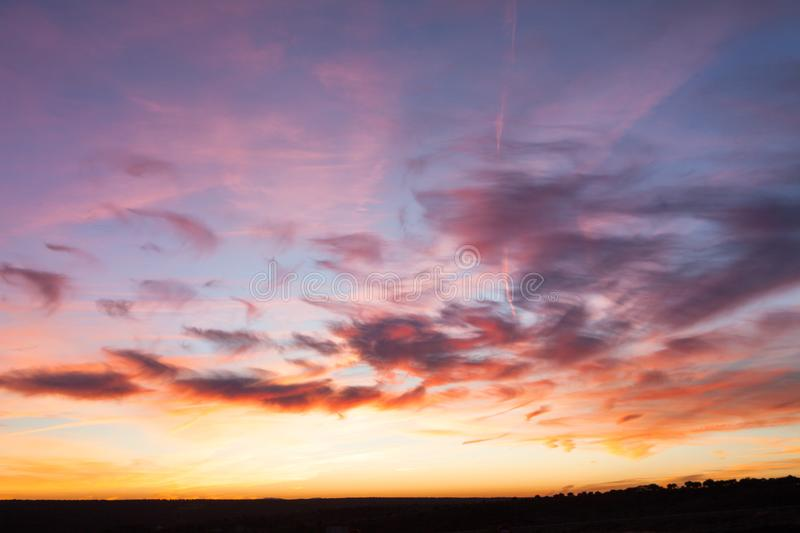 Awesome dramatic fire-red burning sunrise sky stock photography