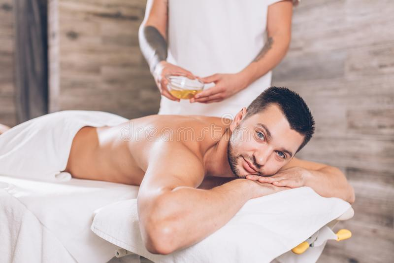 Awesome guy is waiting for back massage stock images