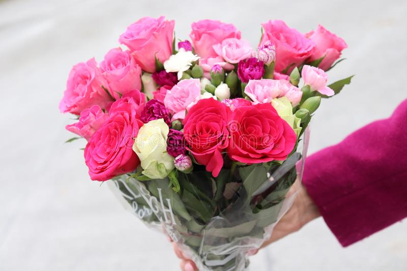 Flower bouquet in hand. Awesome looking flower bouquet. Perfect for Valentines Day royalty free stock photography