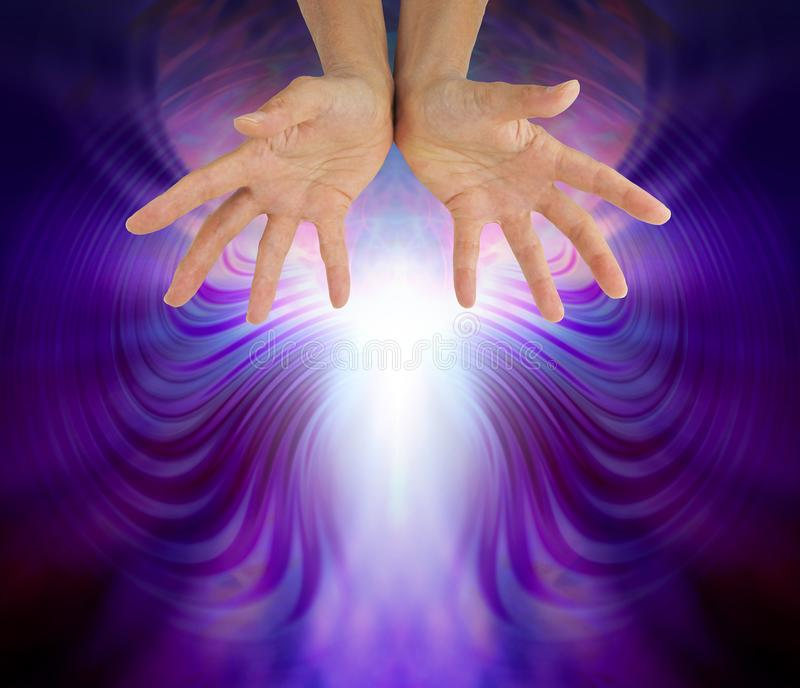 Awesome Quantum Healing Energy Field. Hands outstretched sensing beautiful quantum healing energy with copy space below stock image