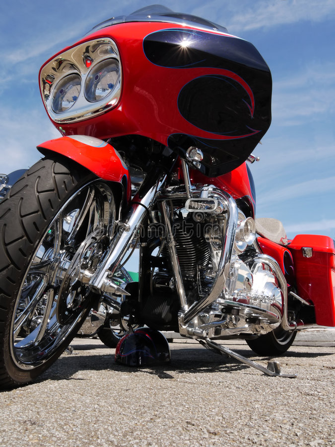 Awesome red harley motor bike royalty free stock photography