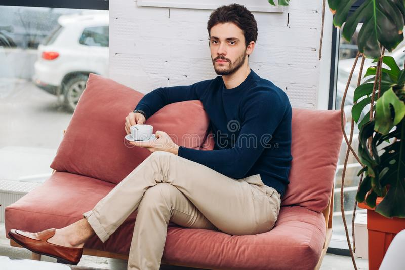 Awesome serious guy with a cup of tea stock image