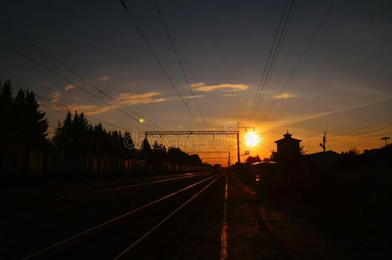 Railway station at sunset stock photography