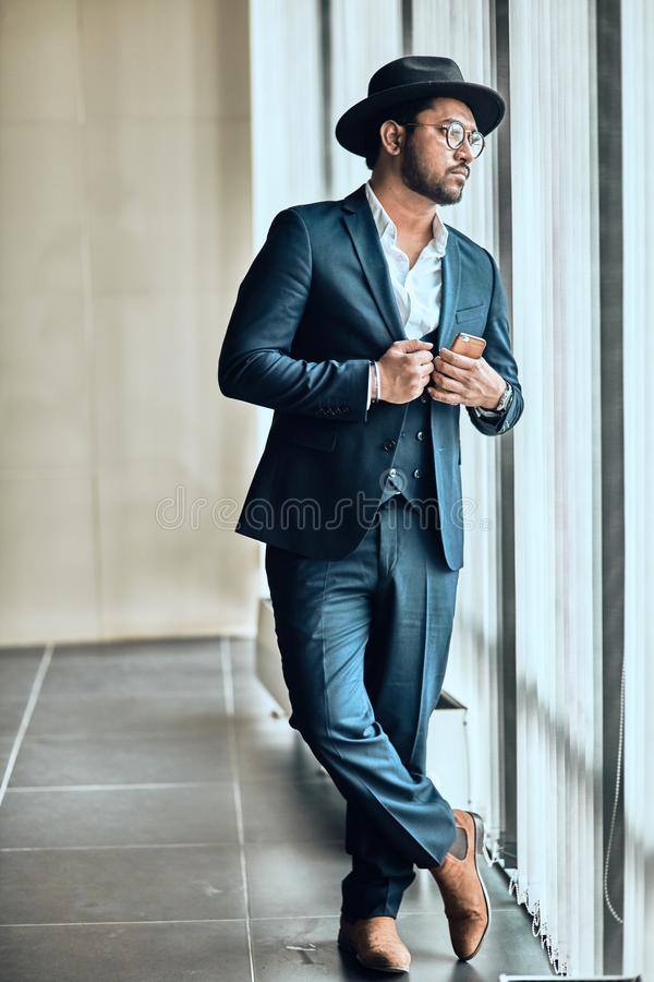 Awesome stylish guy is waiting for her girlfriend royalty free stock photos