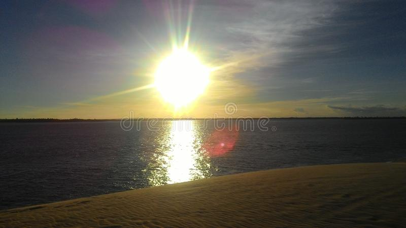 Awesome sunset in front of the Atlantic Ocean. With clear sky and calm water royalty free stock photos