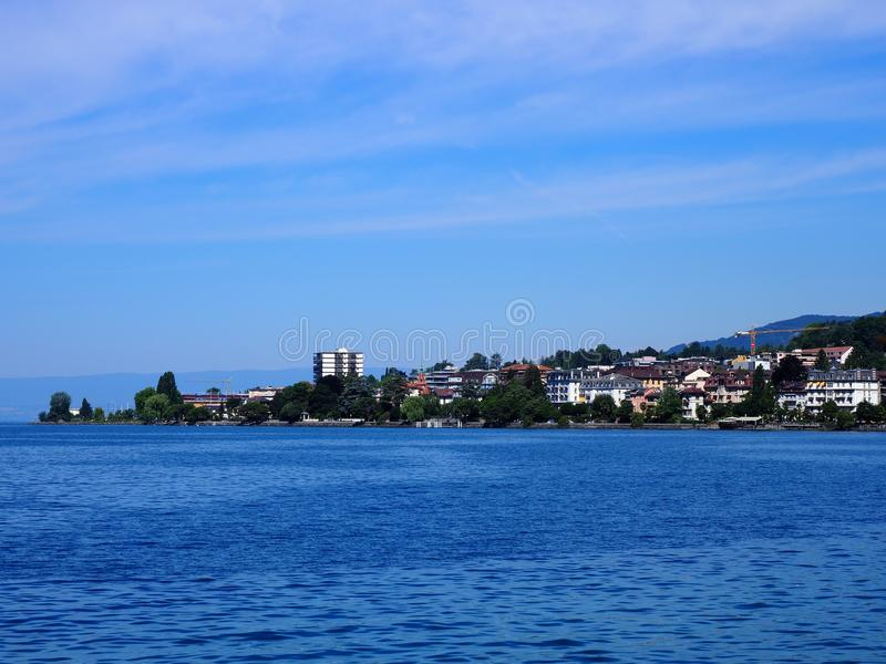 Awesome view of Lake Geneva landscape and swiss promenade in european city of Montreux at alpine riviera in SWITZERLAND royalty free stock images