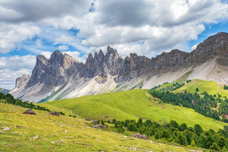 Awesome view at a mountain range with peaks in the dolomites royalty free stock photo