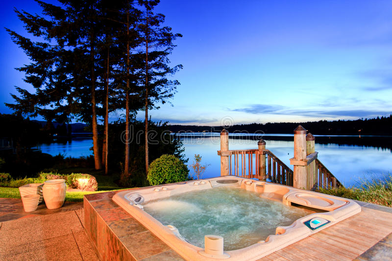 Awesome water view with hot tub at dusk in summer evening. royalty free stock image