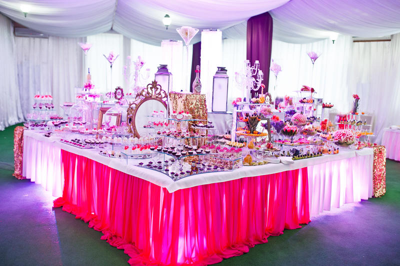 Awesome wedding reception of food and drink. With various pink light stock photos