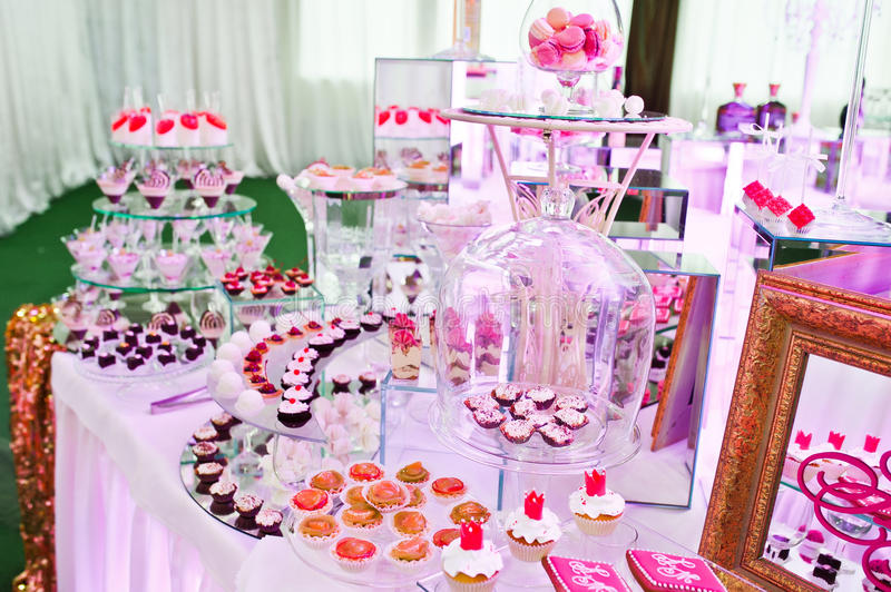 Awesome wedding reception of food and drink. With various pink light stock photo