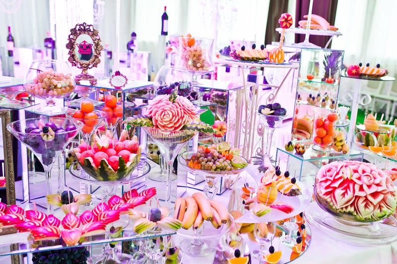 Awesome wedding reception of food and drink. With various pink light stock images