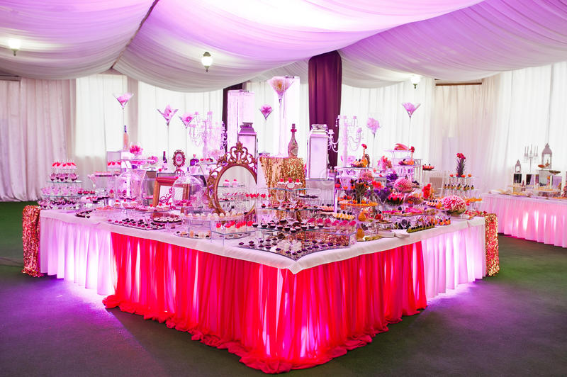 Awesome wedding reception of food and drink. With various pink light royalty free stock photos