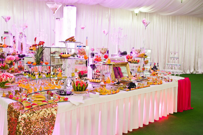 Awesome wedding reception of food and drink. With various pink light royalty free stock images