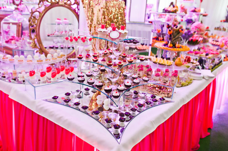Awesome wedding reception of food and drink. With various pink light stock image