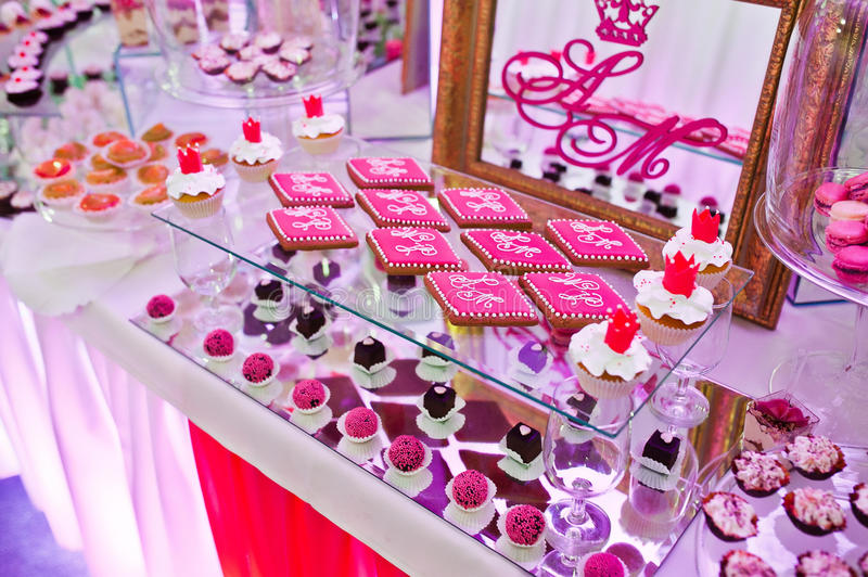Awesome wedding reception of food and drink. With various pink light, cookies on mirror royalty free stock photos