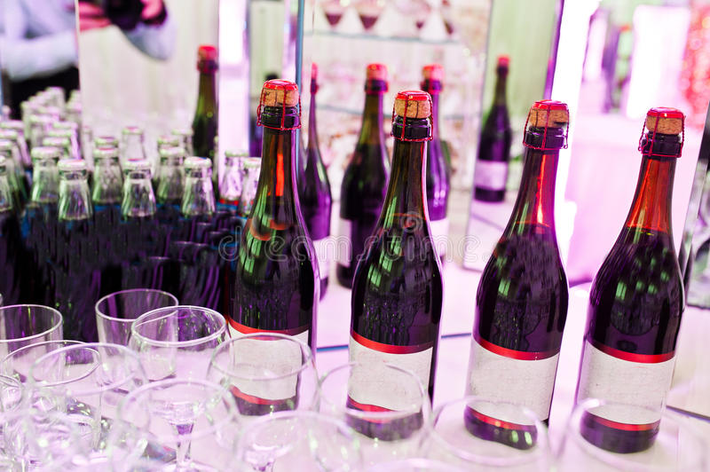 Awesome wedding reception of food and drink. With various pink light, four bottles of champagne stock photo