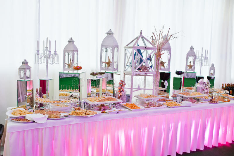 Awesome wedding reception of food and drink. With various pink light, nuts cheese snacks stock images