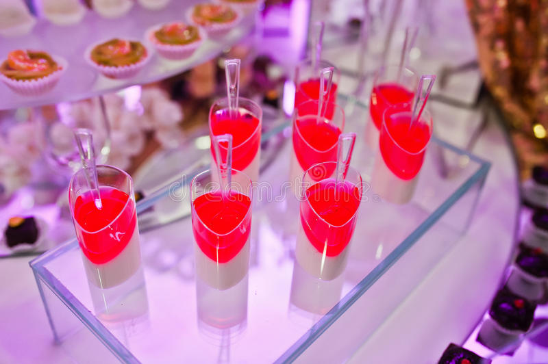 Awesome wedding reception of food and drink. With various pink light, sweet jelly royalty free stock photo
