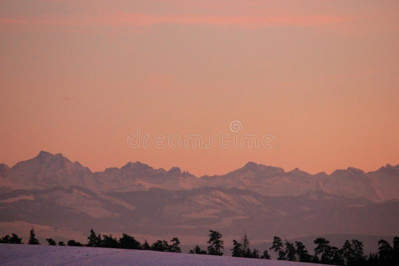 Awesome winter atmosphere with a beautiful sunset on a winter evening royalty free stock photos