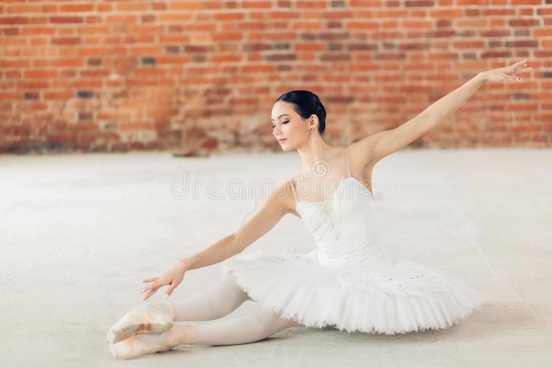 Awesome young talented girl trying to tuch her toe while dancing stock images