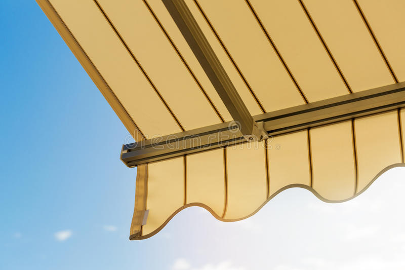 awning against blue sky stock image